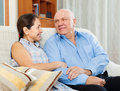 Happy mature couple together sitting on couch in home Royalty Free Stock Photography