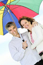 Happy mature couple with umbrella Stock Image