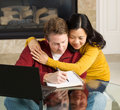 Happy mature couple working from their home photo of close displaying happiness while with fireplace in background Stock Photos