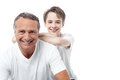 Happy mature father and son posing smiling holding hand on his shoulder Royalty Free Stock Photography