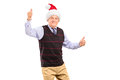 Happy mature gentleman with hat giving thumbs up Royalty Free Stock Images