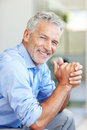 Happy mature male entrepreneur smiling Royalty Free Stock Images