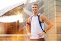 Happy mature male jogger portrait of with earphone looking at camera outdoor Royalty Free Stock Images