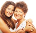 Happy mature mother ang adult daughter portrait of embracing her and looking at camera Royalty Free Stock Image
