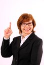 Happy mature redhead business woman with eyeglasses enthusiastic number one close up Stock Images