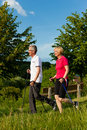 Happy mature or senior couple doing Nordic walking Royalty Free Stock Photography