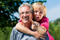 Happy mature or senior couple having walk Royalty Free Stock Image