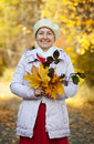 Happy mature woman    in autumn Royalty Free Stock Images
