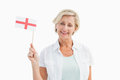Happy mature woman holding english flag on white background Royalty Free Stock Photography