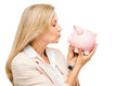 Happy mature woman holding piggy bank isolated on white backgrou business Stock Images