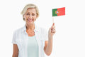 Happy mature woman holding portugal flag on white background Stock Photography