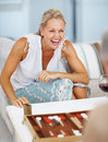 Happy mature woman playing backgammon Royalty Free Stock Photo