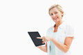 Happy mature woman pointing to tablet pc on white background Royalty Free Stock Image