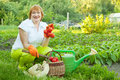 Happy mature woman with vegetables Royalty Free Stock Photo