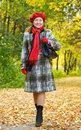 Happy mature woman  walking in autumn Royalty Free Stock Image