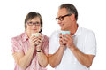 Happy matured couple holding cofee mug Royalty Free Stock Images