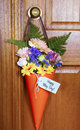 Happy May Day gift of flowers on door. Royalty Free Stock Photo