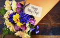 Happy May Day traditional gift of Spring Flowers. Royalty Free Stock Photo