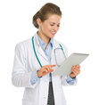 Happy medical doctor woman using tablet PC Royalty Free Stock Photo