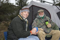 Happy Men Having Coffee On A Camping Trip Stock Photo