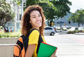 Happy mexican female student outdoor in city Royalty Free Stock Photo