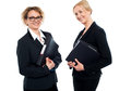 Happy middle aged business females holding files Royalty Free Stock Image