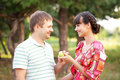 Happy middle aged couple with apple. Stock Photos