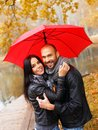 Happy middle aged couple on autumn day with umbrella outdoors beautiful rainy Royalty Free Stock Photo