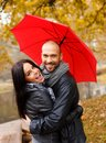 Happy middle aged couple on autumn day with umbrella outdoors beautiful rainy Royalty Free Stock Images