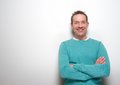 Happy middle aged man smiling with arms crossed Royalty Free Stock Photo