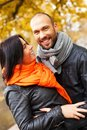 Happy middle aged outdoors couple on beautiful autumn day Royalty Free Stock Photo
