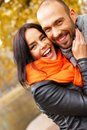 Happy middle aged outdoors couple on beautiful autumn day Royalty Free Stock Photography