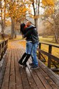 Happy middle aged outdoors couple kissing on beautiful autumn day Stock Photography