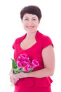 Happy middle aged woman with flowers isolated on white background Royalty Free Stock Images