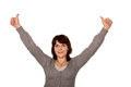 Happy middle aged woman showing thumbs up sign and raising hands isolated on white background Stock Image