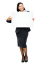 Happy mixed race business woman pointing at empty copy space iso Royalty Free Stock Images