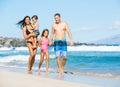 Happy Mixed Race Family on the Beach Royalty Free Stock Photo