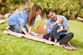 Happy Mixed Race Family Playing In The Park Royalty Free Stock Photography