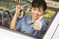 Happy Mixed Race Woman in Car Holding Keys Stock Photo