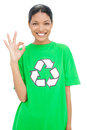 Happy model wearing recycling tshirt making okay gesture on white background Royalty Free Stock Photo