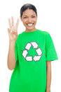 Happy model wearing recycling tshirt showing three fingers on white background Stock Photography