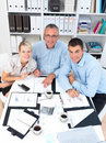 Happy modern business team - looking up at you Royalty Free Stock Images