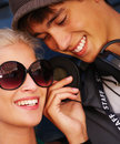 Happy modern young teenage couple smiling Stock Photo