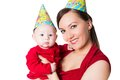 Happy mom and baby celebrating happy birthday Royalty Free Stock Photo