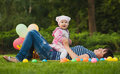 Happy mom and baby are playing in the park on green grass Stock Images