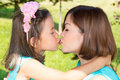Happy mom and child girl hugging and kiss. The concept of childhood and family. Beautiful Mother and her baby outdoor