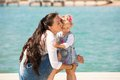 Happy mom and child girl hugging on nature. Beautiful Mother and her baby outdoor Royalty Free Stock Photo