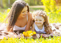 Happy mom and daughter having fun in summer day Stock Image