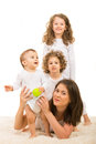 Happy mom and kids on top mother with daughter each other mother holding toddler boy Royalty Free Stock Photography