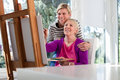 Happy mom painting and daughter smiling Royalty Free Stock Photos